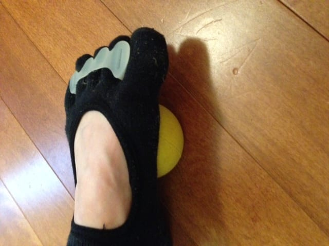 foot on a yoga tune up ball